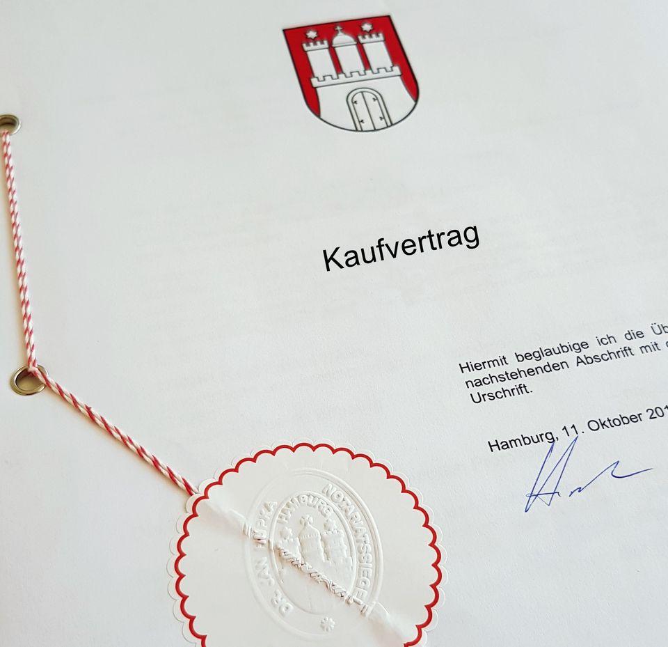 Symbolbild Immobilienkauf: Dargestellt ist ein notariell beglaubigter Kaufvertrag der Stadt Hamburg.